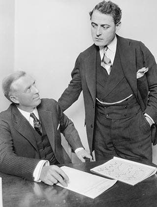 Two businessmen having discussion in office © Everett Collection/Shutterstock.com