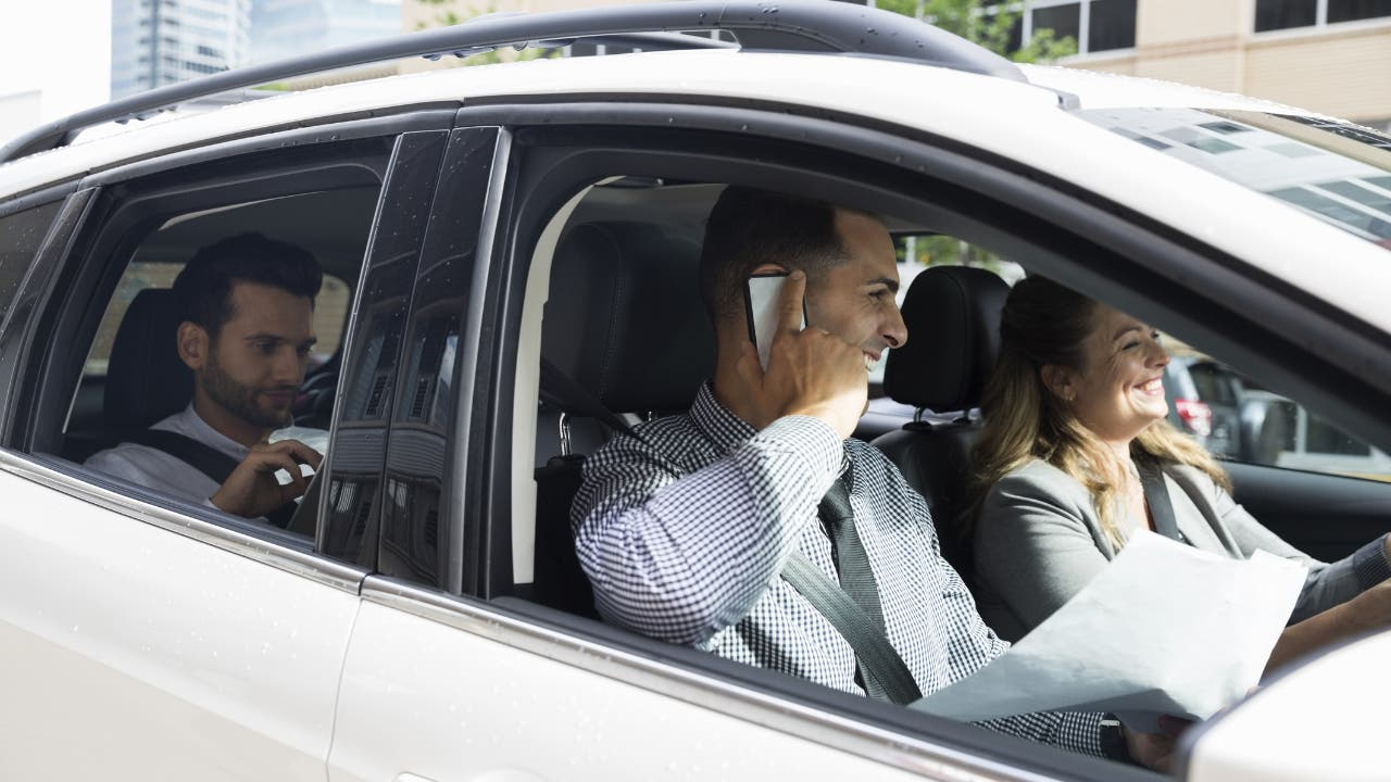 business people driving a car