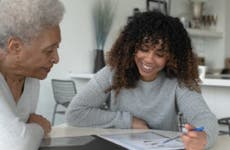 An African American Adviser Meets with A Senior Client