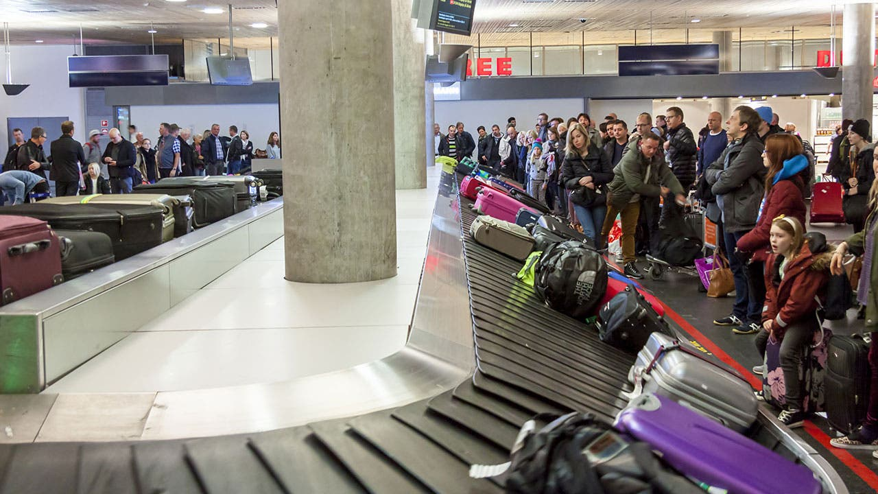 Passengers waiting for bags in baggage claim