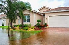 Floodwaters closing in on home