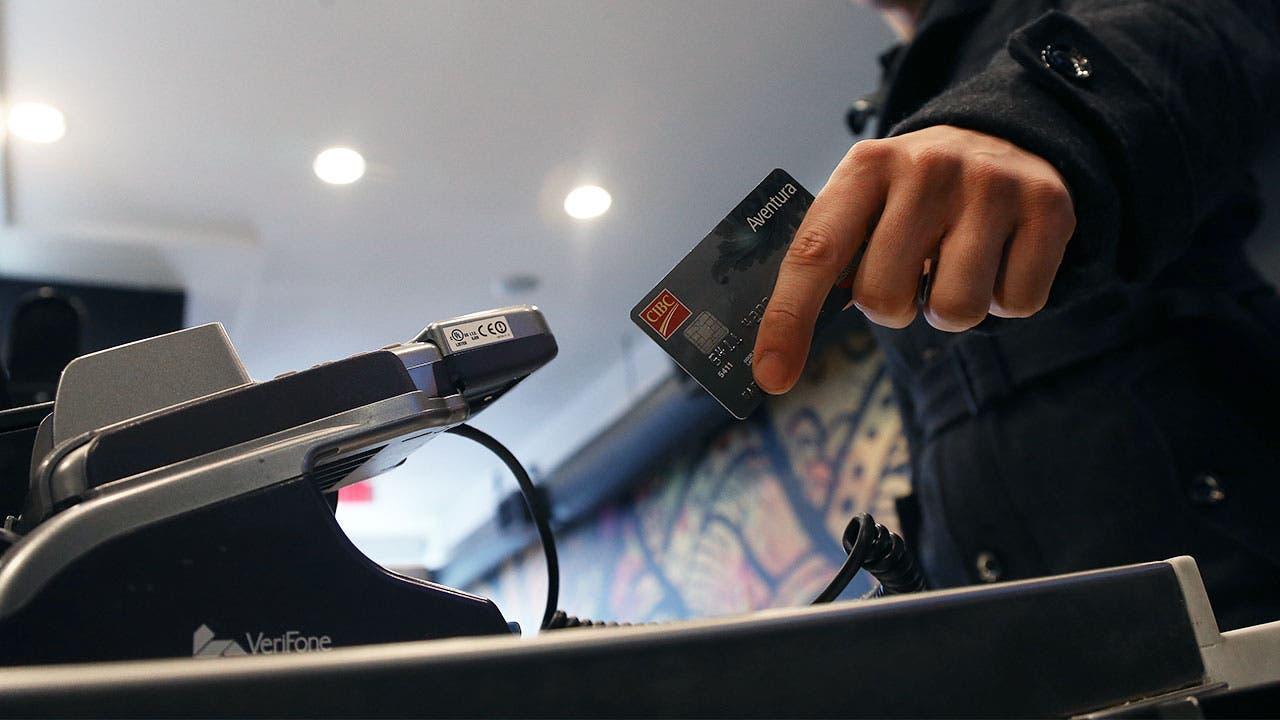 Man swiping credit card