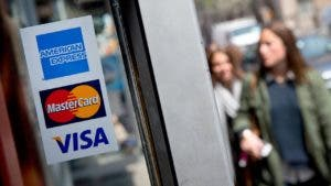 Window stickers of American Express, MasterCard and Visa