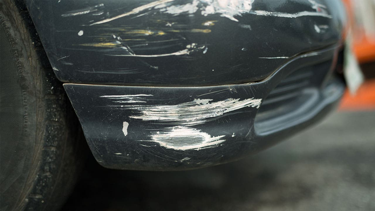 Scratched car bumper