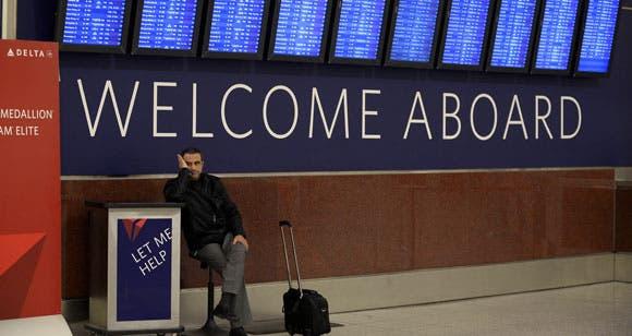 tax-blog-airline-passenger-waiting-underneath-departure-board
