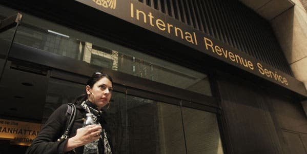 taxes-blog-a-woman-walks-out-of-an-internal-revenue-service-office-in-new-york