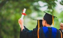 College student raising diploma