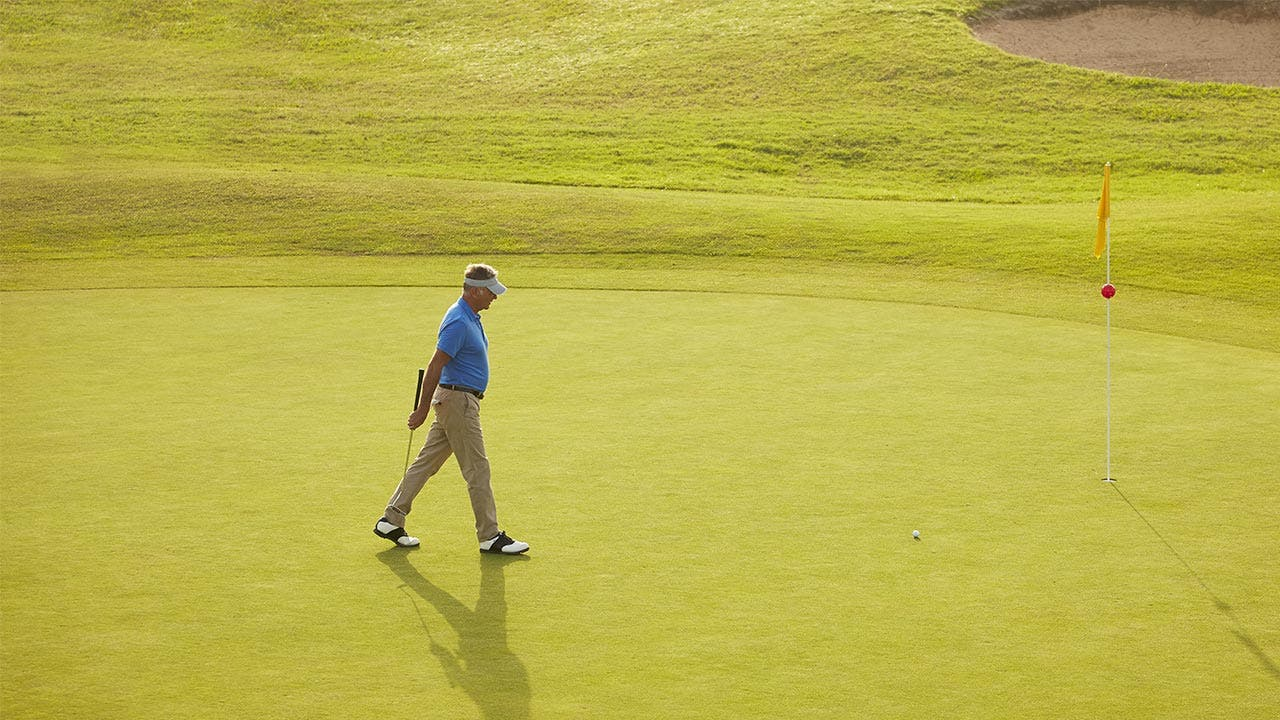 Man on golf course playing a game