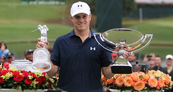 Jordan Spieth with his trophies after the final round of the 2015 Tour Championship in Atlanta. © Michael Wade/Icon Sportswire/Corbis