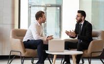 Two men discussing finances.