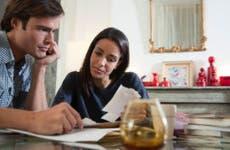 Man and woman looking at bank statements