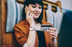 Young woman making credit card purchase over the phone