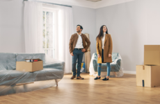 Man and woman move into a new home