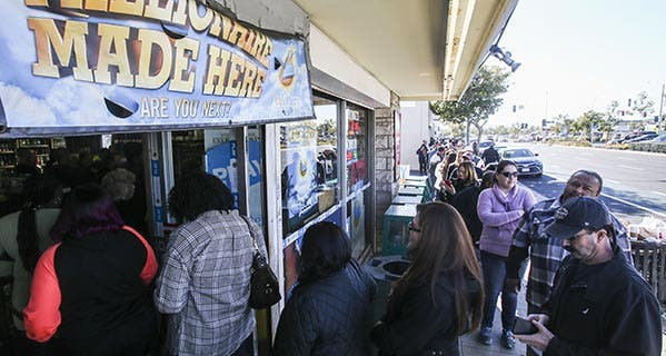 People line up to buy Powerball lottery tickets in Hawthorne, California. That state doesn't tax lottery winnings. © Ringo Chiu/ZUMA Press/Corbis