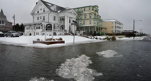 Ice forms as the winter storm mixed with high tide causes flooding on Beach Avenue in Cape May, New Jersey. Andrew Renneisen/Getty Images News/Getty Images