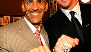 NFL head coach Tony Dungy and NFL quarterback Peyton Manning display the Super Bowl rings at an event in 2007. The Broncos have 2 Super Bowl wins under Manning: XLI and 50.