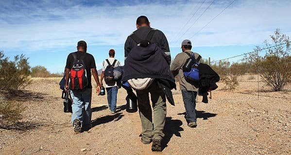 Undocumented Mexican immigrants, above, had hoped to find construction or landscaping jobs in Arizona. They returned to their homes in the Mexican state of Sonora. John Moore/Getty Images