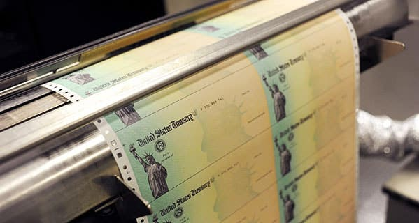 U.S. Treasury checks may be delayed a bit this year as the IRS ramps up efforts to fight tax refund fraud. William Thomas Cain/Getty Images