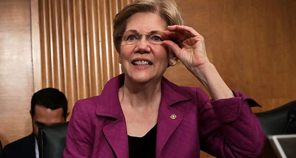 Sen. Elizabeth Warren, D-Mass., introduced a bill that would simplify tax filing, but it has drawbacks. Alex Wong/Getty Images