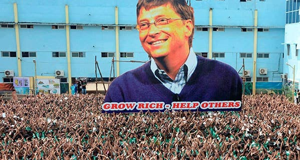 Indian schoolchildren gather around a larger-than-life cutout of Microsoft founder and philanthropist Bill Gates, whose foundation focuses on solving health care problems around the world. STR/AFP/Getty Images