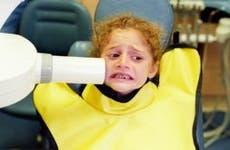 Child not enjoying the dentist's chair