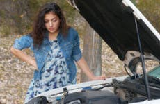 Woman under the hood of a car