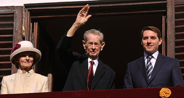 Former King of Romania Michael I makes a rare appearance saluting the audience with Princess Margareta and Prince Nicolae. KARINA KNAPEK/AFP/Getty Images
