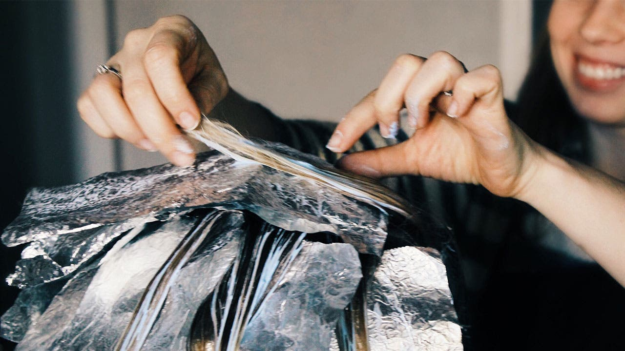 Hait stylist applying foils