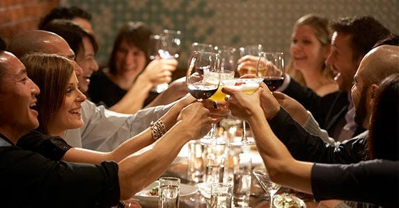 Friends toasting at a restaurant