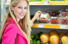 Young woman shopping in a grocery supermarket in produce section © l i g h t p o e t/Shutterstock.com
