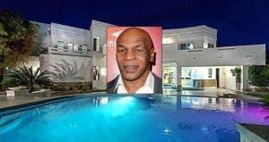 Mike Tyson | Tommaso Boddi/Getty Images; House: Realtor.com
