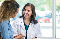 Female doctor discusses something with young woman patient