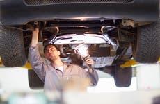 Car mechanic doing an alignment