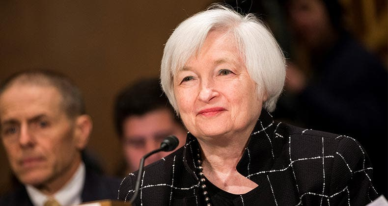 Janet Yellen smiling at conference | Anadolu Agency/Getty Images