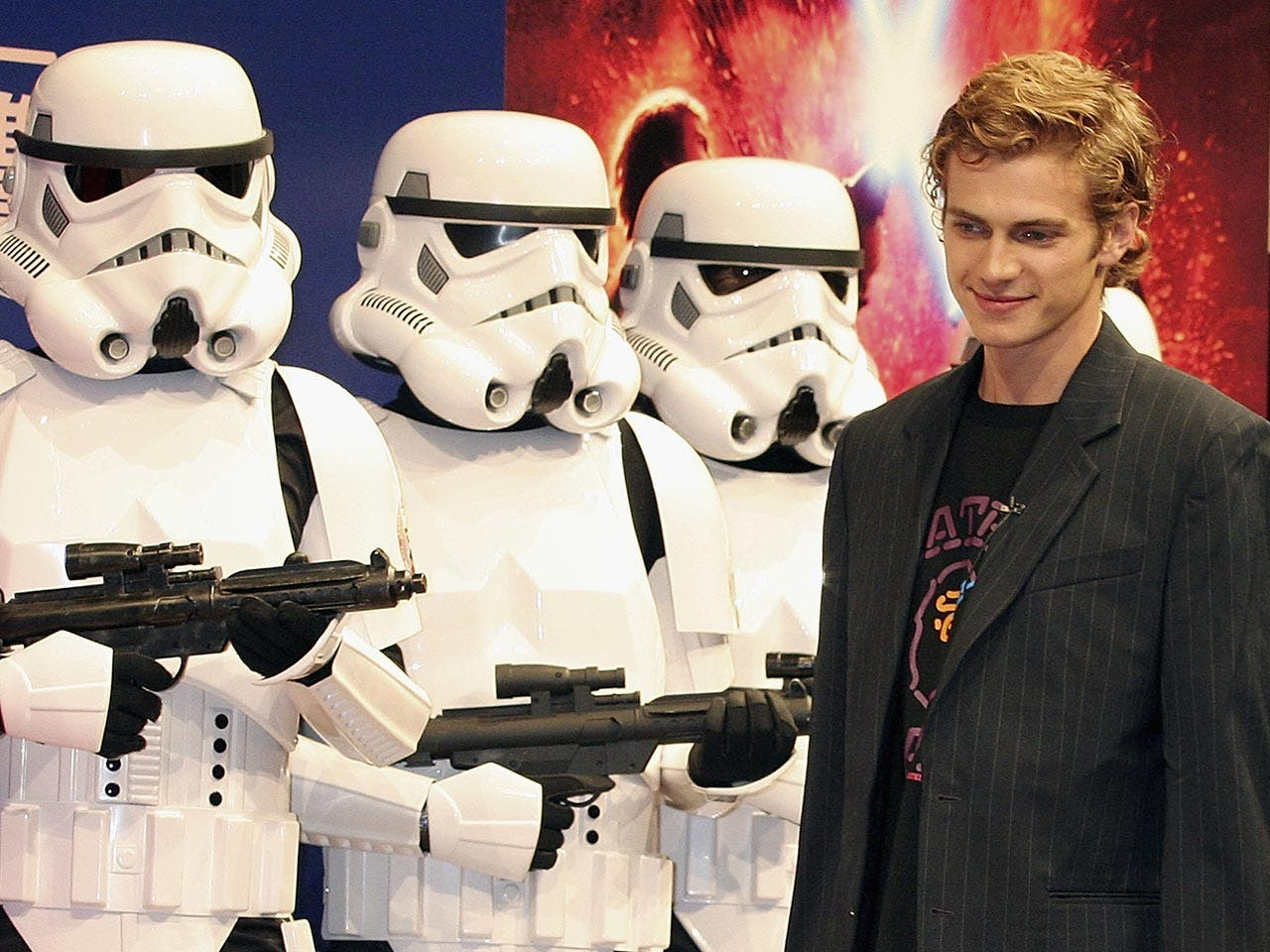 Hayden Christensen stands with Stormtroopers during a photocall to promote the film