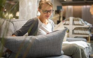 Woman shopping for apartment furnitures | l i g h t p o e t/Shutterstock.com