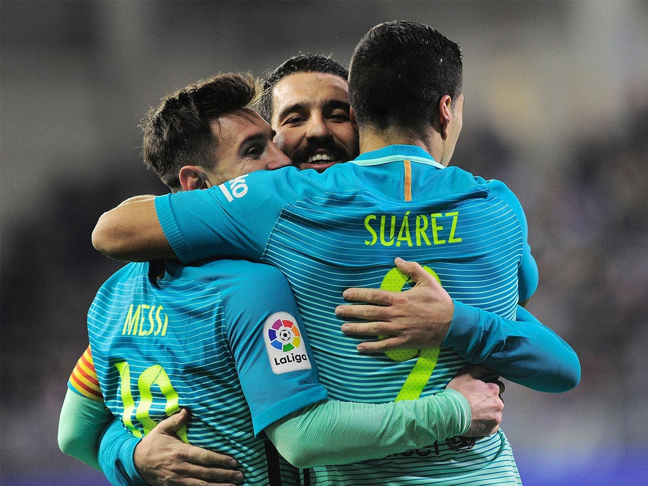 Suarez, Messi, team hug | ANDER GILLENEA/Getty Images