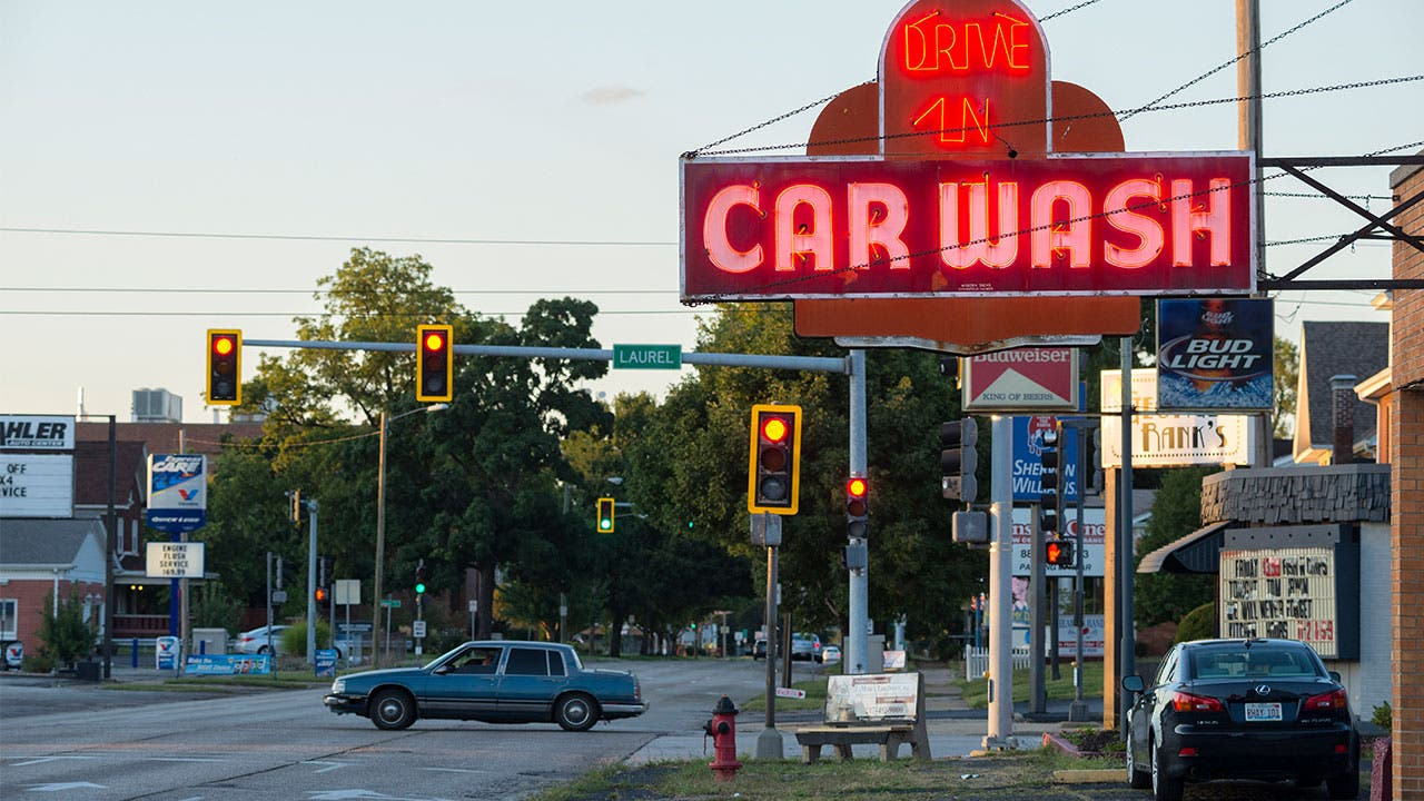 Street with sign for car wash