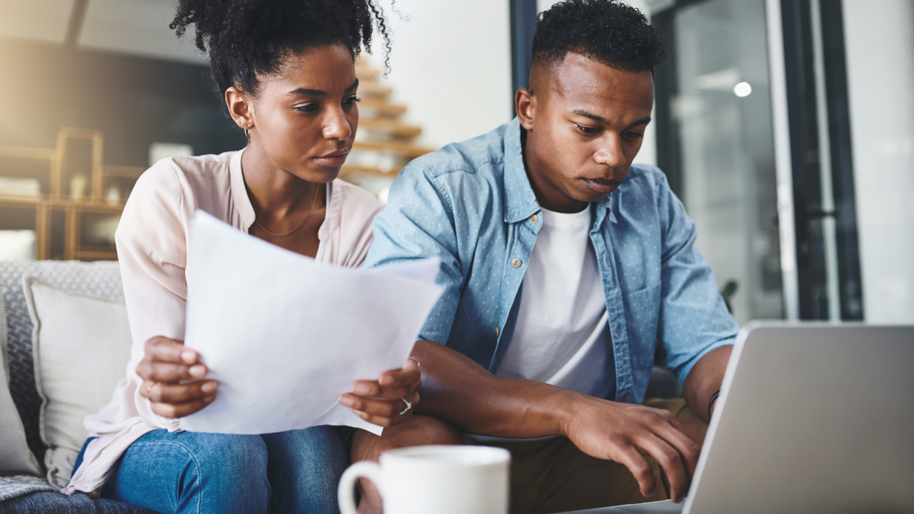 Young couple going through their paperwork together at home