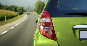 Green car on the road © Olaru Radian-Alexandru/Shutterstock.com