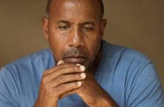 Solemn-looking man sitting and thinking © iStock