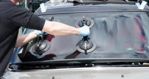Technician replacing car windshield | sylv1rob1/Shutterstock.com
