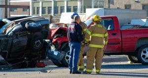 Emergency workers at scene of car crash © iStock
