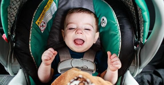 Baby in green car seat | Jamie De Pould/Moment/Getty Images