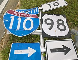 Dodge damaged road signs © spirit of america/Shutterstock.com