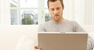 Man sitting with laptop © MJTH/Shutterstock.com