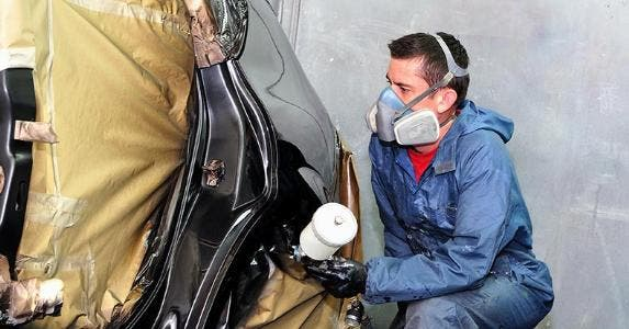 Car body shop maker painting vehicle   loraks/Shutterstock.com
