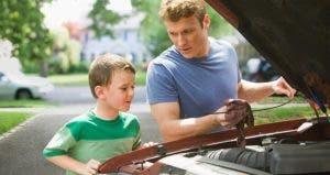 Father showing his son a car's engine | KidStock/Getty Images