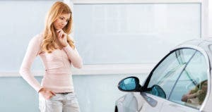 Young woman thinking about car © iStock