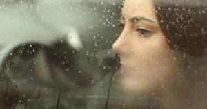 Woman on driver's seat looking out the window and rain | Antonio Guillem/Shutterstock.com